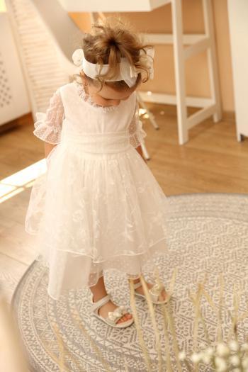 Kremowa sukienka z tiulu w...