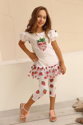Kremowe legginsy w truskawki